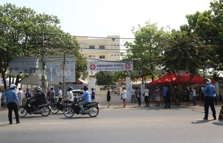 People wait in line for Covid-19 testing after a new cluster emerged at Phnom Penh's Chak Angre Health Center on February 22, 2021. (Chorn Chanren/VOD)