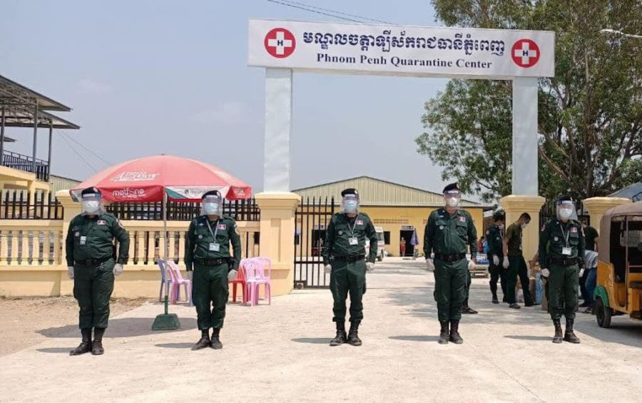 Authorities stand at attention outside a Phnom Penh quarantine center in February 2021. (Phnom Penh Police Facebook)