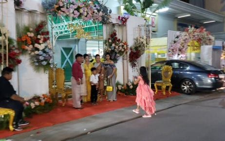 """A group of people poses a photo at a wedding hall entrance at Phnom Penh's Lucky Star Hotel on February 21, 2021, the day the """"February 20"""" Covid-19 cluster was announced. (Danielle Keeton-Olsen/VOD)"""