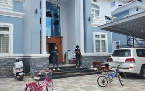 Authorities guard a villa in Borey Angkor Phnom Penh where an alleged kidnapping attempt and fatal shootout occurred, in a photo posted to the Phnom Penh Military Police Facebook page on March 1, 2021.