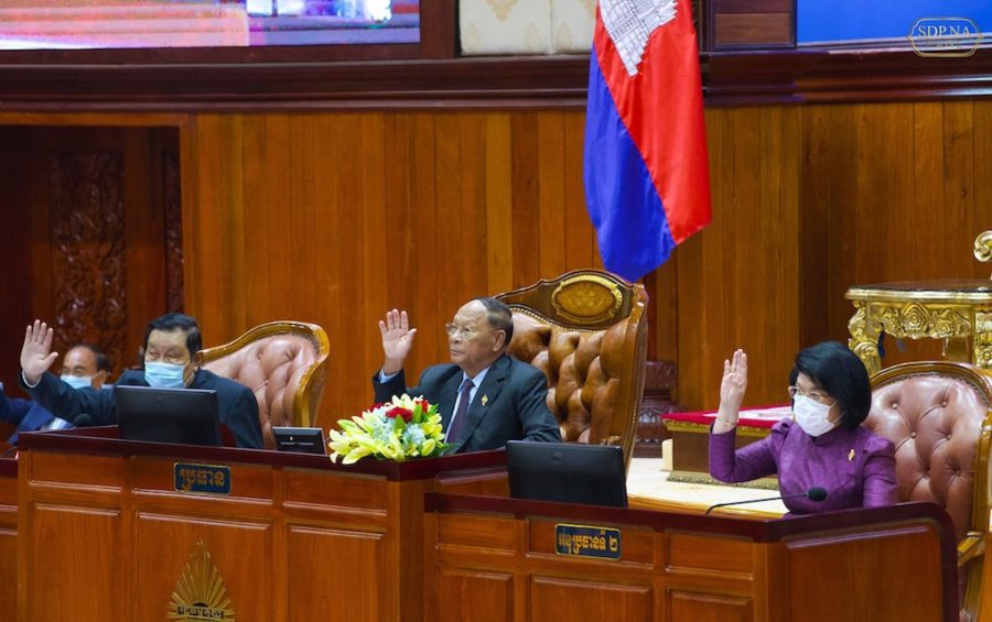 National Assembly President Heng Samrin, center, raises his hand at the National Assembly on March 5, 2021, in this photograph posted to his Facebook page.