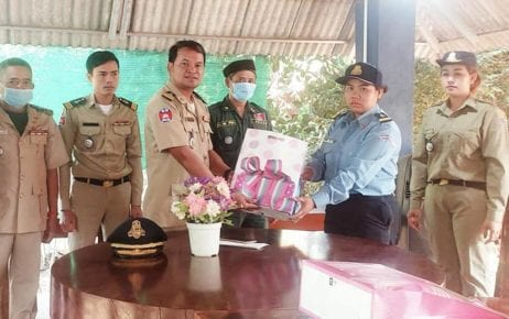 Siem Pang district police chief Chim En presents traffic police officer Sithong Sokha with a gift, in this photograph posted to the district police's Facebook page on March 8, 2021.