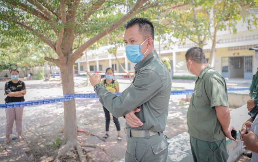 Kandal provincial authorities at a quarantine site in Takhmao City on March 10, 2021. (Kandal provincial police Facebook page)