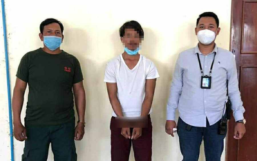 A man arrested in connection to a social media post in which he tells factory workers not to receive Chinese Covid-19 vaccines, on March 24, 2021. Wrists blurred in handout photo. (Phnom Penh Municipal Police)