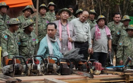 Environment Ministry spokesperson Neth Pheaktra shows confiscated chainsaws at the Prey Lang Wildlife Sanctuary during a government-organized trip, on February 14, 2021. (Tran Techseng/VOD)