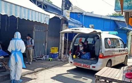 Health workers investigate a Phnom Penh residence while Covid-19 patients wait in the back of an ambulance van in a photo posted to the Stung Meanchey commune hall Facebook page on April 26, 2021.