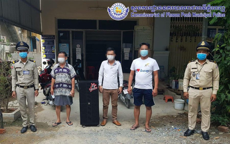 Three men arrested for partying and singing karaoke despite Covid-19 restrictions were released Wednesday but could still face fines (National Police)