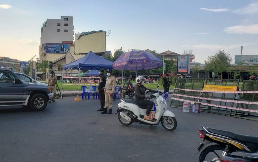 Authorities stop drivers at a barricade in front of the Cambodia-Japan Friendship Bridge into the Chroy Changvar commune