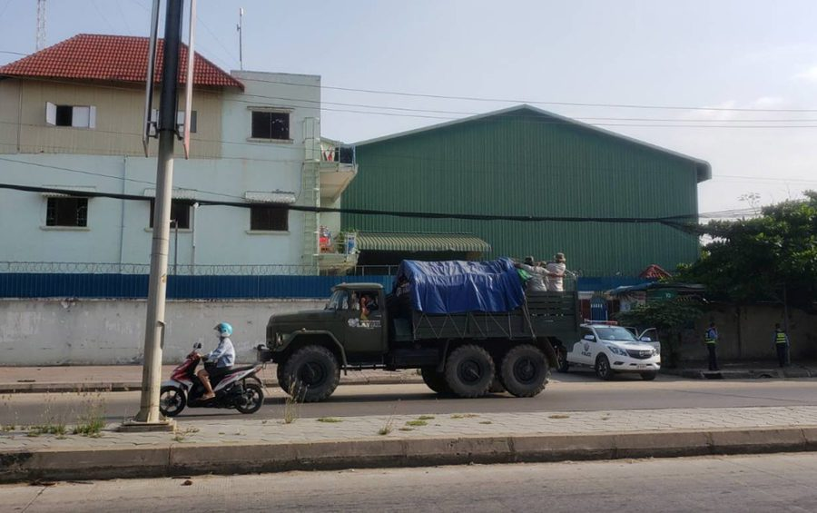 A military truck drives alongside a motorbike on Phnom Penh's Veng Sreng Blvd on May 11, 2021. (Danielle Keeton-Olsen/VOD)