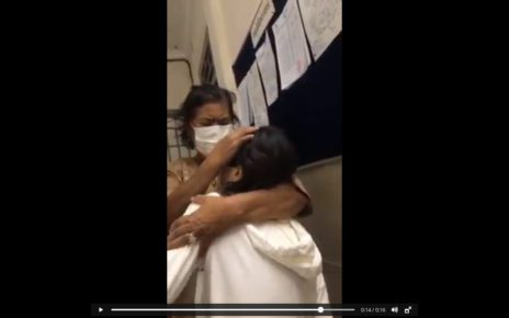 Mean Pich Rita is comforted by her mother in a video posted to social media.