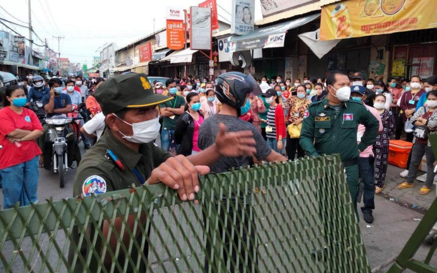 Protesters face police officers at a red-zone barrier in Meanchey district's Stung Meanchey III commune on May 13, 2021, in a photo posted to the commune police's Facebook page.