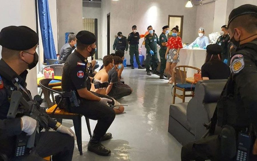 Police raid a condominium in Phnom Penh's Boeng Keng Kang II commune for drugs on May 18, 2021. (National Police)