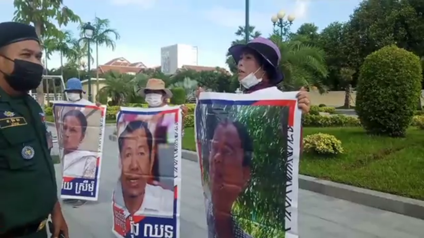 Protesters outside the US Embassy on May 28, 2021 call for the release of political prisoners amid a Covid-19 outbreak in the country's prisons, in a screenshot from a video supplied by protesters' families.
