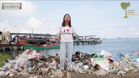 Mother Nature activist Sun Ratha stands in front of a pile of trash on the beach in Sihanoukville in a screenshot from a video posted to Facebook on January 24, 2020.