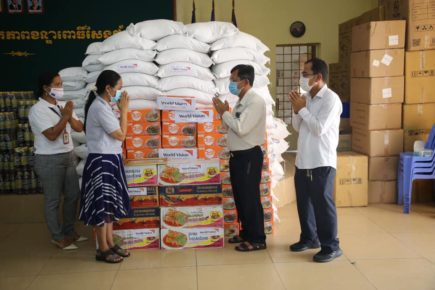 Representatives from the NGO World Vision donate Mee Chiet instant noodles and other food to the Pur Senchey district office for distribution in a photo posted to the district's Facebook page on May 14, 2021.