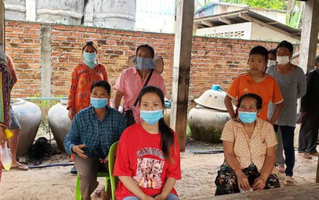 Banteay Dek commune residents, including Sok Kakada, 24 (center), and Cheang Sinoun (left) gather and speak about a protest and arrest over disputed land in Kandal province's Kien Svay district on June 2, 2021. (Danielle Keeton-Olsen/VOD)