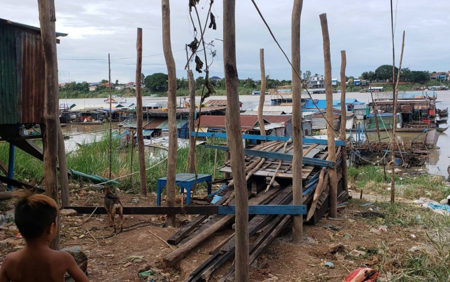 Stilts and materials from a dismantled house in Phnom Penh's Prek Pnov village. A landed resident said one of the people who was told to evacuate their floating homes attempted to reassemble a home on land but was stopped by authorities, on June 10, 2021. (Danielle Keeton-Olsen/VOD)