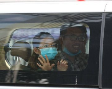 Sun Ratha, left, and Yim Leanghy sit inside a car in a photo posted to Mother Nature Cambodia's Facebook page on June 20, 2021.