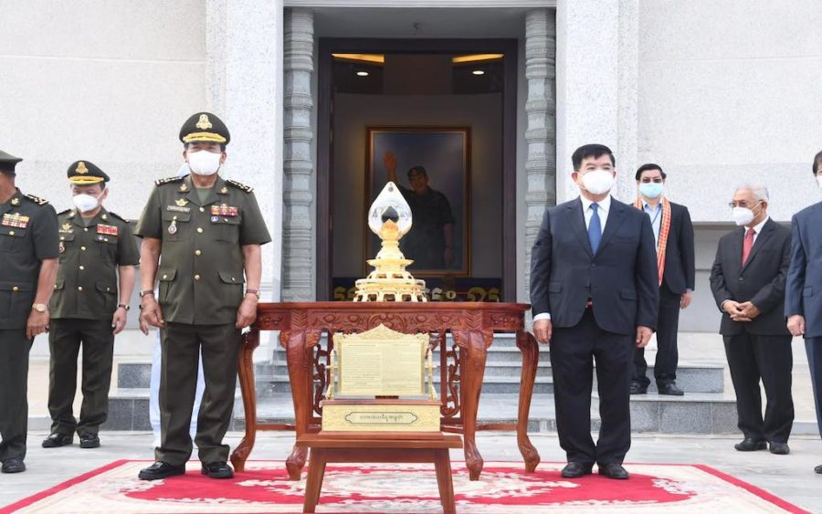 Defense Minister Tea Banh and Energy Minister Suy Sem place Cambodia's first drops of oil at Phnom Penh's Win-Win Memorial on June 9, 2021. (Tea Banh/Facebook)