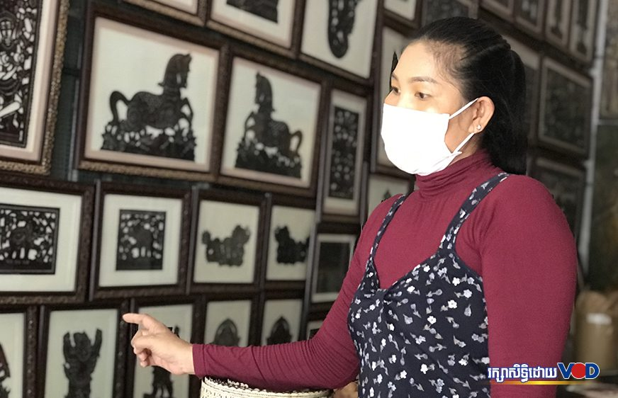 Soun Sinak points to the leather artwork she sells at her shop in Siem Reap city's Nokor Thom commune on July 5, 2021.  (Pork Kheuy/VOD)