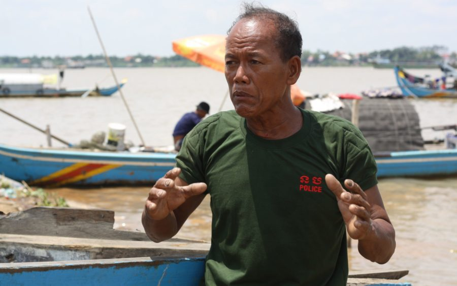 Saman Kosim, 60, talks about the damage to his boat after being hit by a sand barge, in Phnom Penh on July 12, 2021. (Michael Dickison/VOD)