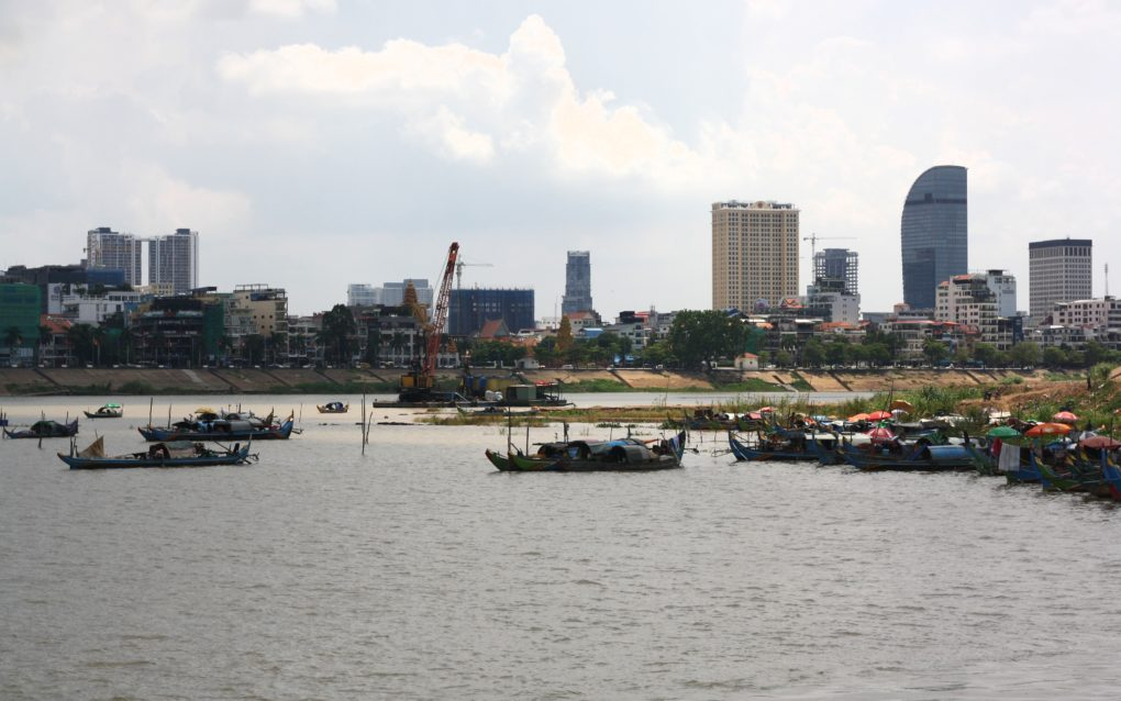 Sand dredging and fishing boats on the Phnom Penh waterfront, on July 12, 2021. (Michael Dickison/VOD)