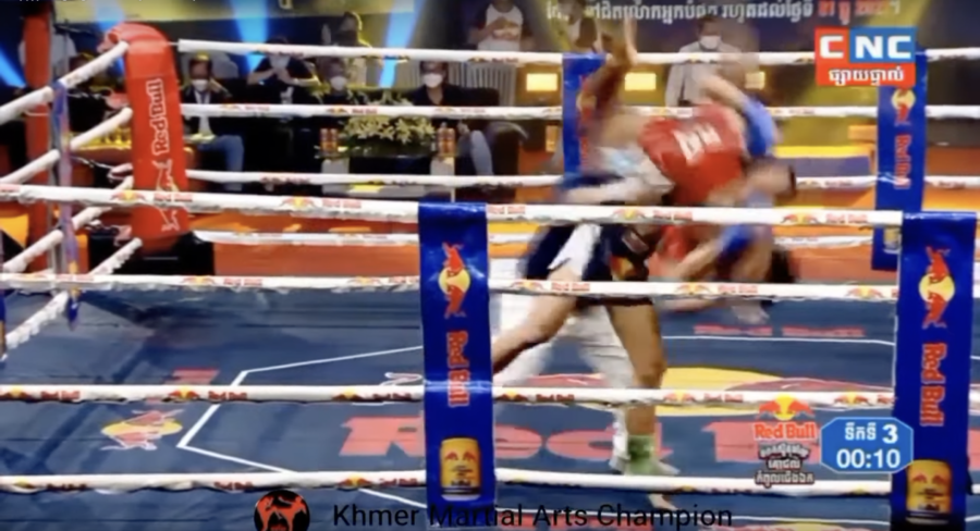 Kun Khmer boxer Moeun Mekhea lifts his opponent Khim Bora and slams him on the mat, in a screenshot from the July 10 bout broadcast on CNC.