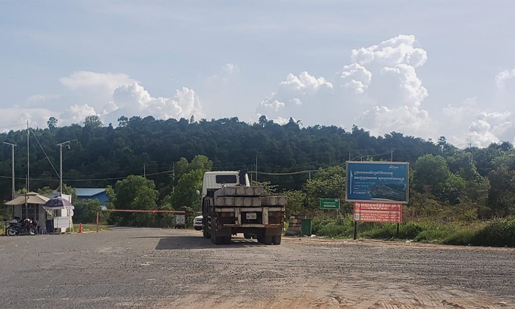 A truck loaded with cement beams stops in front of a checkpoint within the Union Development Group concessions in Koh Kong's Kiri Sakor district on June 28, 2021. (Danielle Keeton-Olsen/VOD)