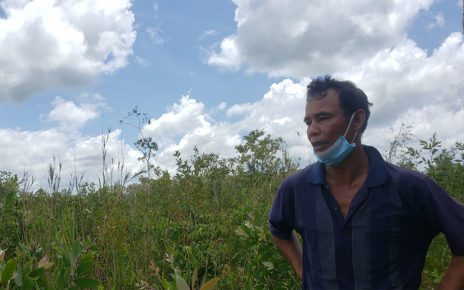 Hong Sok, 48, a farmer in dispute with Heng Huy Agriculture Group over his family's farmland, stands in front of an area that he says was cleared, in Koh Kong province's Sre Ambel district on June 29, 2021. (Danielle Keeton-Olsen/VOD)