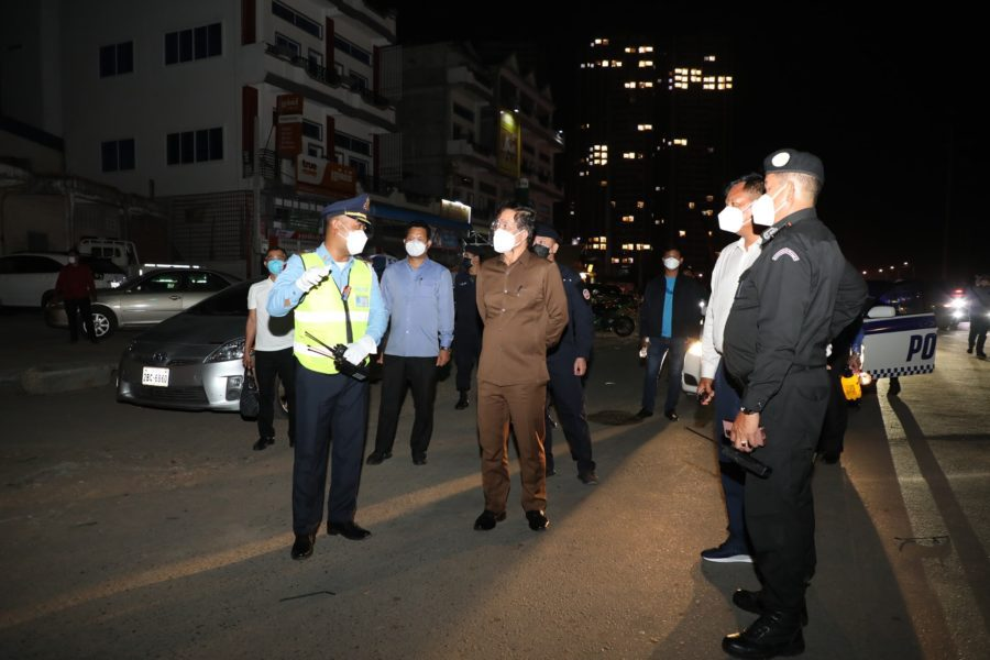 Phnom Penh governor Khuong Sreng, center, speaks to officers while monitoring Covid-19 curfews on July 31, 2021, in a photo posted to the Phnom Penh City Hall Facebook page.