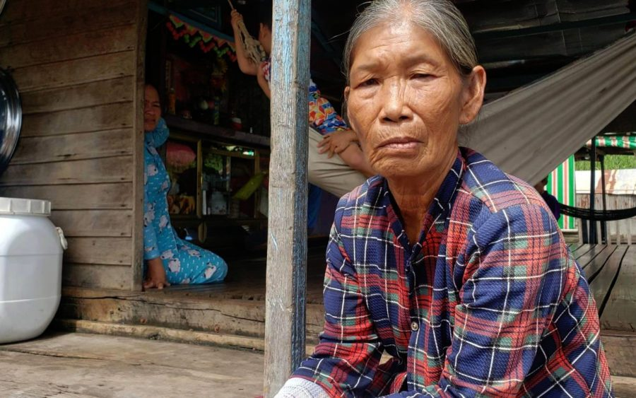 Nhung, 61, born in Cambodia, escaped targeted killings against ethnic Vietnamese residents during the Khmer Rouge era. She speaks to reporters after being evicted from her home on the river by Phnom Penh authorities. (Danielle Keeton-Olsen)