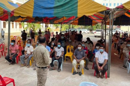 Provincial officials and frontline workers wait in a tent for 3rd vaccine doses ahead of the border reopening, in a photo posted to the Banteay Meanchey Administration's Facebook page on August 9, 2021.
