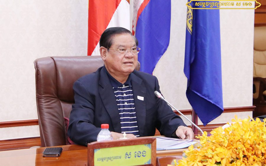 Deputy Prime Minister Sar Kheng at a podium during a meeting, in a photo posted to his Facebook page on August 9, 2021.