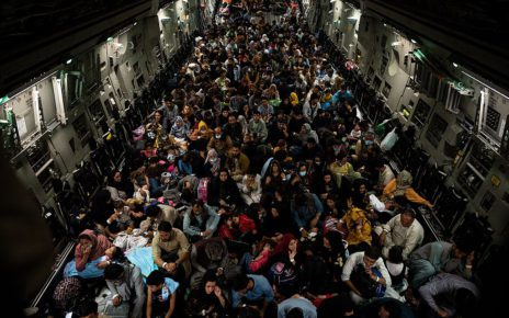 Hundreds of Afghan civilians who allied with the U.S. stand on a plane leaving Afghanistan as the Taliban took over, in a photo posted by the U.S. Air Force on August 18, 2021. (Wikimedia Commons)