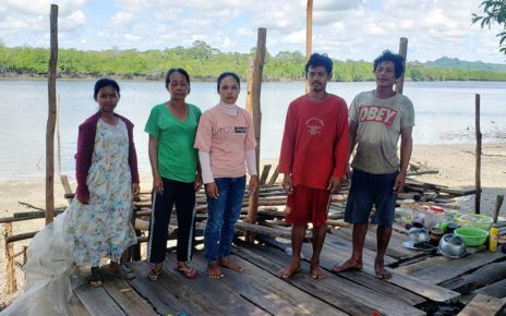 Meah Ream, 58, second from left, stands with four members of her family on the platform left of their house after Union Development Group guards allegedly destroyed it in late June, in Koh Kong's Kiri Sakor district on June 28, 2021. (Danielle Keeton-Olsen/VOD)