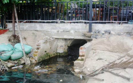 Wastewater is discharged from under a cafe into the river in Kampot city, on August 25, 2021. (Michael Dickison/VOD)