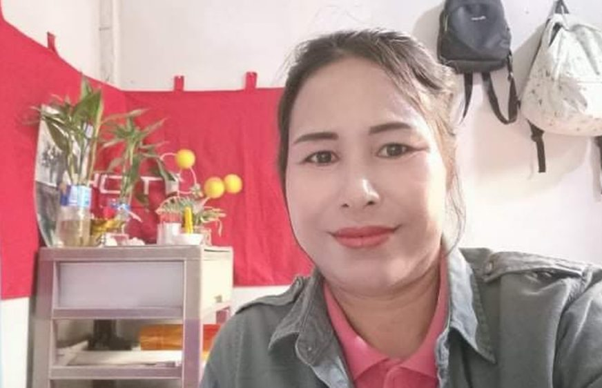 Chum Sorphorn, former opposition city councilor in Kampong Speu province, sits in her rented room in the outskirts of Bangkok. (Supplied)