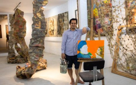 Srey Bandaul, co-founder of Phare Ponleu Selpak, stands among sculptures and paintings in a gallery, in a photo provided by Phare.