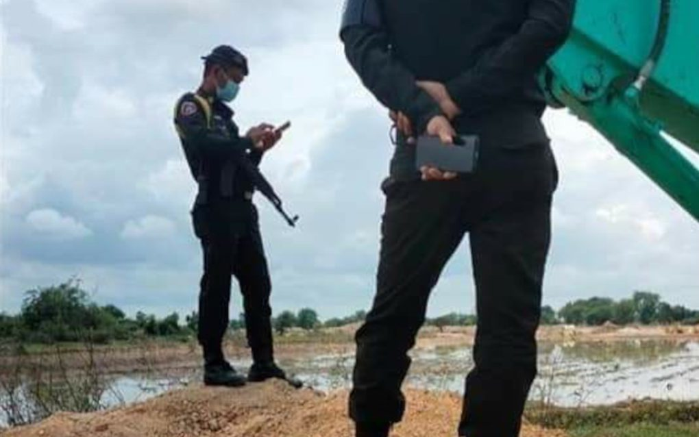 Armed guards stood by as authorities dug a ditch into land disputants' land in Kandal province's Kandal Stung district on September 1, 2021. (Supplied)