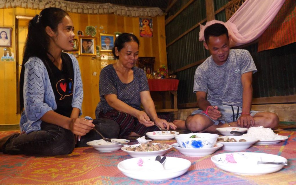 Kea Channa, Boun Nai and Kea Sokun eat dinner together at their home in Siem Reap for the first time in a year after Sokun's release from prison on September 3, 2021. (Jack Brook/VOD)