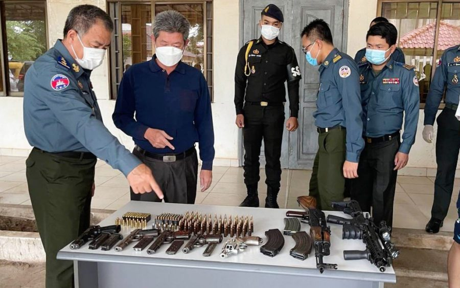 Preah Sihanouk governor Kouch Chamroeun inspects a haul of weapons from an alleged kidnapping, in a photo posted to the Preah Sihanouk military police's Facebook page.