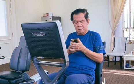 Prime Minister Hun Sen on his phone, in a photo he posted to his Facebook page on September 15, 2021.