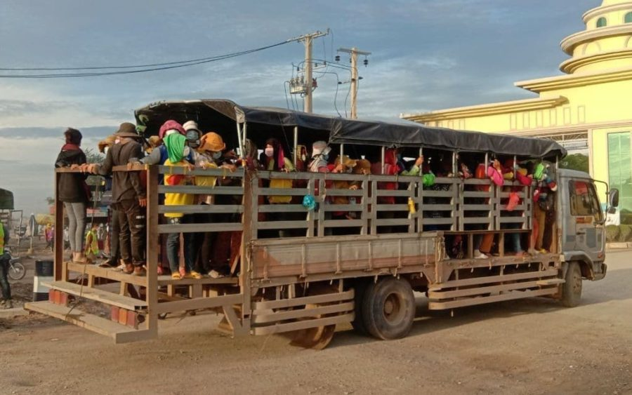 Garment factory workers commute on the back of a truck in Kandal province on September 21, 2021. (AIP Foundation)
