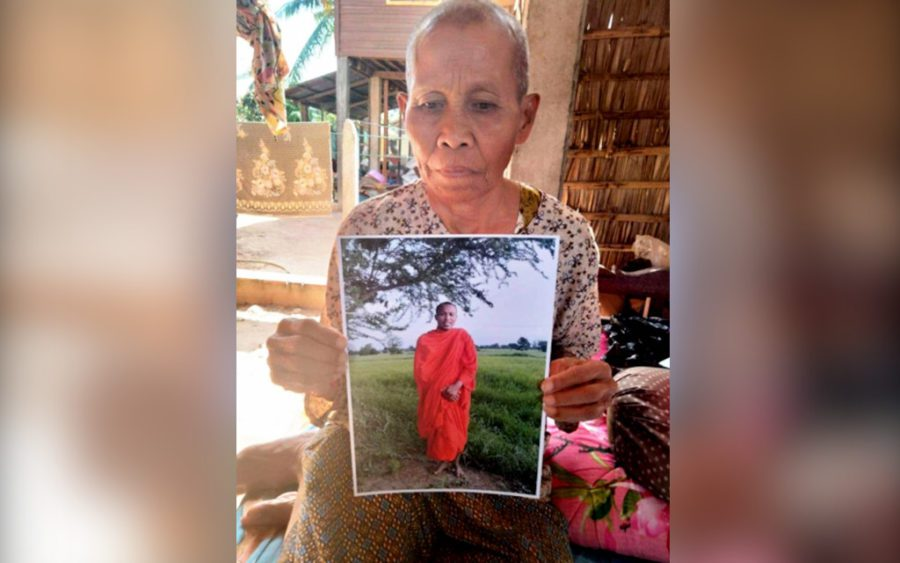 Cham Yem holds a photo of her son, jailed monk activist Koeut Saray. (Soth Ban/VOD)