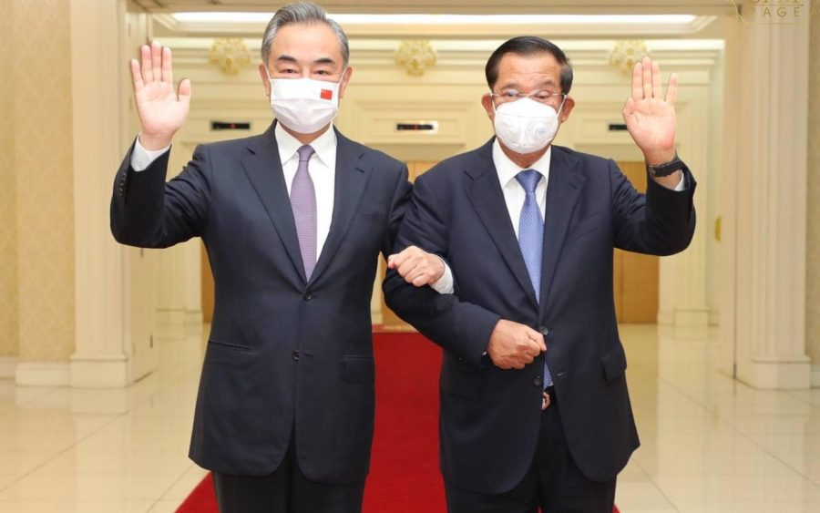 Chinese Foreign Minister Wang Yi and Prime Minister Hun Sen pose for a photograph, which was posted on the latter's Facebook page.