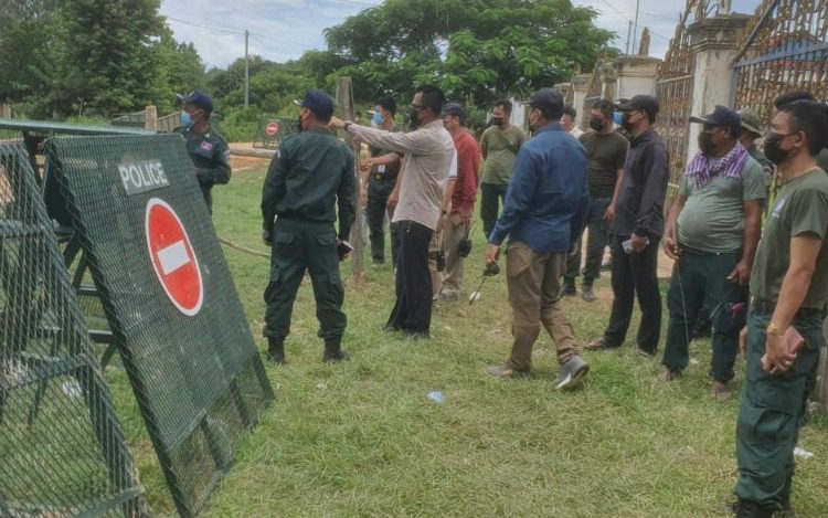 Kandal police officers photographed during the standoff with villagers on Sunday, in a photo posted to their Facebook page.