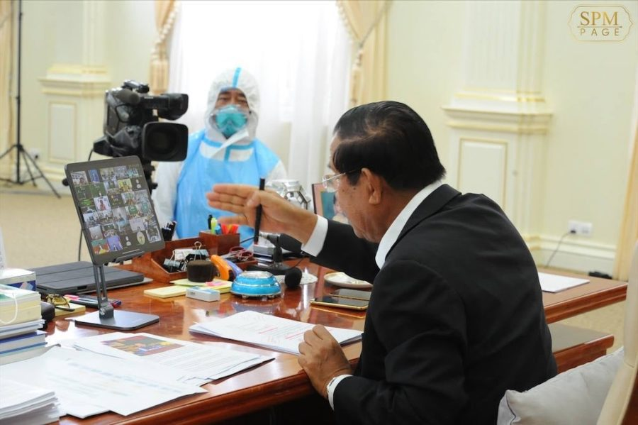 Hun Sen speaks to provincial officials on July 1 ordering the purchase of coffins and herbal remedies while also chastising them over the hoarding of rapid tests in warehouses, in a photo posted to his Facebook page.