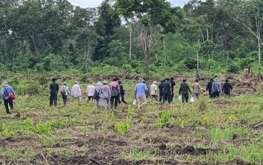 Kratie provincial officials are seen inspecting the cleared land in Chet Borei district on September 8 in a photo posted to the provincial administration's Facebook page.