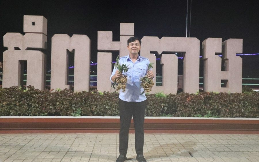 Leng Navatra holds up longan as part of his efforts to procure the fruit from farmers, in a photograph posted to his Facebook page earlier this month.