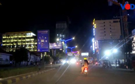 Motorists drive past a KTV.